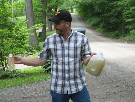 Dimock, Pa. resident Craig Sautner shows off his water.