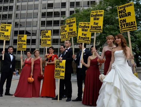 Wedding Party in Chicago borrows anti-war signs for photo