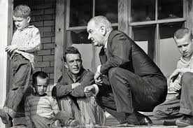 "Soon after President Lyndon B. Johnson declared the ""War on Poverty"" in 1964, he visited Martin County. He was photographed with the Fletcher family on their front porch."