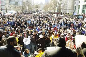 Rev. Barber (back) addresses Moral March